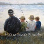 Father and son fishing on the lake width